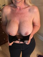 Do you like my titties?  Am I hot? Let me know what you think...the dirtier...